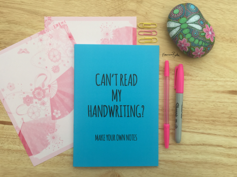 blue notebook, 'can't read my handwriting? Make your own notes'