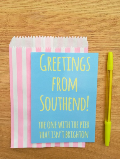 Greetings from Southend blue and yellow postcard